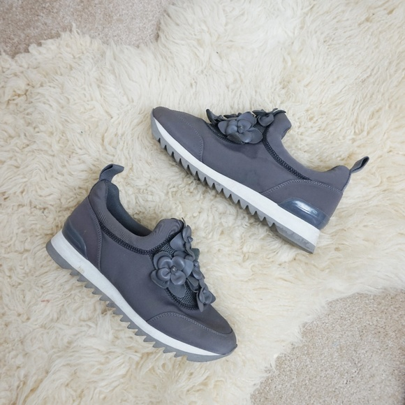 04c4d013b26f Tory Burch Blossom Neoprene Sneakers in Cloud Gray.  M 5b969dd6baebf6be3420aebe